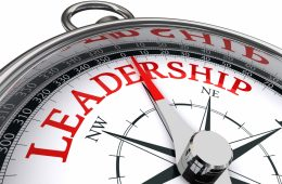 leadership red word indicated by compass conceptual image on white background