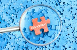 Coaching word on puzzle background